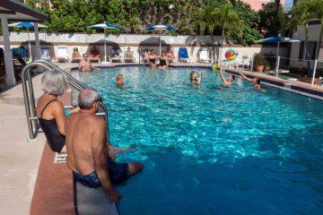 Elderly Couple sitting on Pool edge