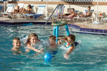 Kids playing in the palm crest pool